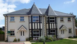 This property in Ferring, Worthing, West Sussex has had new grey slates fitted to it's pitched roof and turrets by Kingsley roofing.