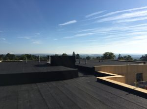 Kingsley Roofing completed a dark grey felt roof on this smart apartment block in Haywards Heath