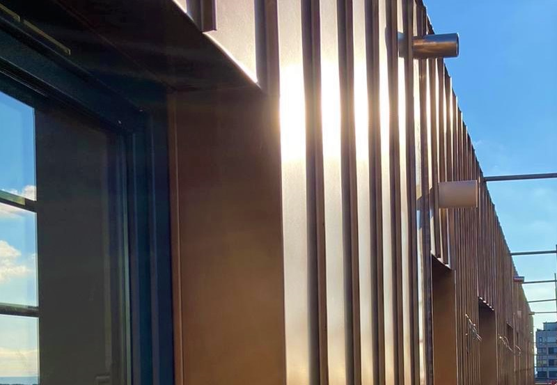 Copper coloured cladding on a block of flats